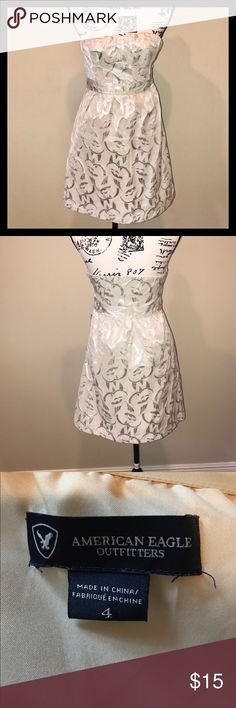 AEO Strapless Dress Size 4 AEO Shimmering Strapless Dress.  A perfect fit to show off your hourglass figure.  Dress has a side zipper.  In great pre-owned condition. American Eagle Outfitters Dresses
