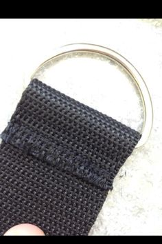 To make the strap, I looped the webbing through the ring and sewed it with a plain stitch