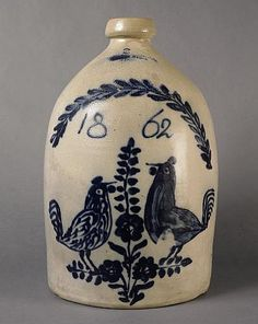 """Keno Auctions. 1/18/11 lot 36.  Description: Salt-Glazed Cobalt-Blue Three-Gallon Stoneware Jug with Pair of Roosters Flanking Flower Stem and Dated 1862.  Impressed , """"WHITES UTICA"""",  h. 16 1/2 in.  Condition : There is a minor abraision on branch above the date, as well as a small firing pebble mark."""