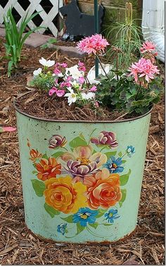 Vintage Trash Can Planter.  Love this idea for the garden. Trailing flowers would look so sweet.