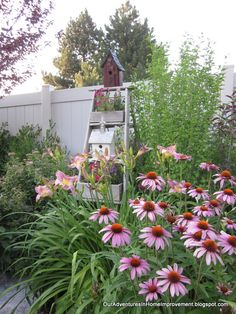 Repurposed red wagons made into planters in front of a bed spring trellis fill a back corner of my yard. - All For Garden Dream Garden, Garden Art, Garden Ideas, Garden Paths, Garden Projects, Diy Projects, Garden Ladder, Hummingbird Garden, Spring Garden