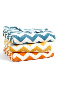 This colorful chevron plush throw will add a gorgeous pop of color to any space.