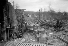 Candor, Oise, France. Soldiers and a dog outside a ruined house in 1917. (Bibliotheque nationale de France) #