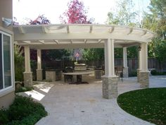 This is what I have been picturing for our future patio.. on a smaller scale of course! Stone bases for rounded pergola.