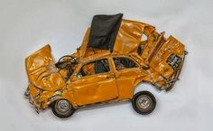 crushed cars yellow fiat