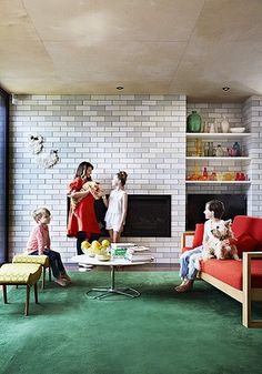(From left to right) Woody, Bec – holding Clancy – Saskia, Erzsike and Rex the dog in the modern lounge room. The orange sofa is from Temperature Design. Modern Lounge Rooms, Orange Sofa, Armelle, Australian Homes, Woody, Bungalow, Berry, California, Interiors