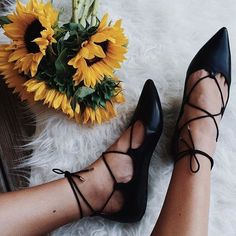 This summer we've seen the lace-up trend take on shoes, tops, dresses and jeans. Our black leather ghillie flats are the on-trend essential, perfect with florals.
