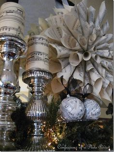 Black and White with Silver at Christmas..~ love the candles covered with sheet music!  decoupage project?