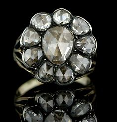 Georgian Diamond Ring Rings were usually styled with a large central stone in the center surround by smaller stones. It was common that the larger central stone was not as valuable as the surrounding stones or was not a stone at all but a paste. This style was commonly created with diamonds