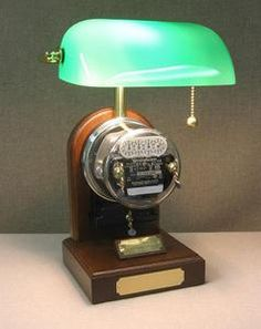 1920s electric meter repurposed as a desk lamp -- watch the meter slowly rotate and click off the watts used when lamp is turned on ... so cool!