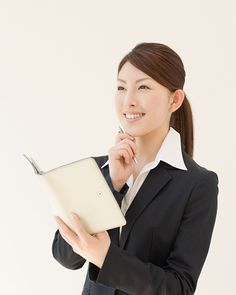 Businesswoman Holding Diary