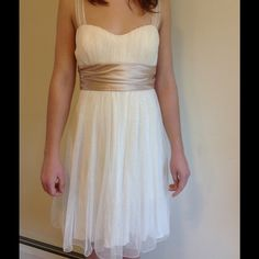 Size 5 cream baby doll dress Size 5 Speechless brand baby doll dress with sparkly sheer layer with tan bow.  Worn once. Speechless Dresses Mini