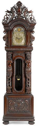 A remarkable Renaissance revival carved mahogany quarter chiming hall clock in the style of R. J. Horner, signed Grand Rapids Clock and Mantel Co., circa 1900