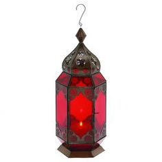 """Moroccan-style hanging candle lantern with red glass panels.       Product: Lantern    Construction Material: Metal and glass   Color: Red   Accommodates:  (1) Candle - not included  Dimensions: 17"""" H x 7"""" W x 7"""" D   Note: Not recommended for outdoor use   Cleaning and Care: Wipe with dry cloth"""