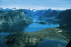 Auyuittuq National Park, Nunavut | Summit Lake marks the highest point in Akshayuk Pass. This large lake was formed by glacial meltwaters in an end moraine. Water from this lake flows both north and south, dropping 500 metres (1,640 ft) before reaching the Arctic Ocean. | Excerpted from Unforgettable Canada: 100 Destinations | Photo by Phot' | 3
