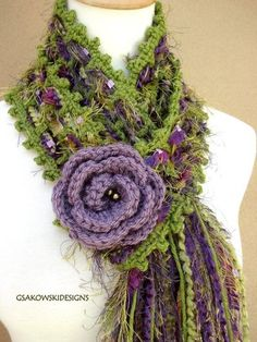 Interesting scarf design (minus the flower) -  the scarf, itself, would take very little time to crochet. It's meshy, probably continuous dc, ch 1 combination all the way through with a picot edging.