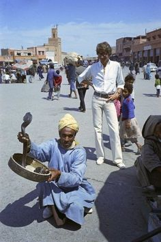 Yves Saint Laurent: Yves Saint Laurent watches a snake charmer in a Moroccan marketplace in March 1972.