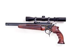 My Encore pistol with custom cocobolo wood stock & 300 whisper barrel. MGM