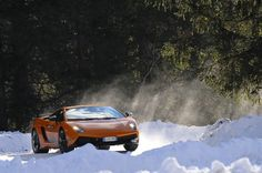 A Lamborghini Aventador races through the snow on an ice track outside of Cortina, Italy. The car sells for $400,000