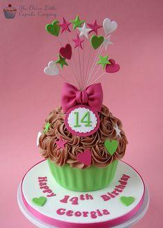 Bright Giant Cupcake Chocolate cupcake with fondant decorations. Giant Cupcake Mould, Chocolate Giant Cupcake, Large Cupcake Cakes, Cupcake Torte, Big Cupcake, Cupcake Cake Designs, Giant Cake, Giant Cupcakes, Fondant Cupcakes