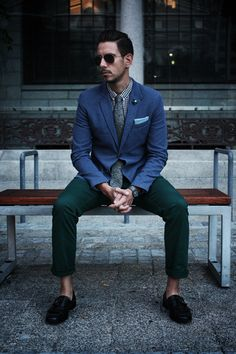 Ray ban aviators, blue blazer, black gingham shirt, grey donegal tweed tie, skull lapel pin, blue pocket square, green skinny chinos, black moccasins
