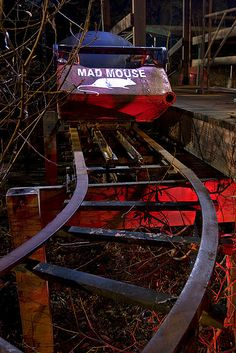The last car on the track of the Mad Mouse roller coaster waits for passengers that will never come. By  Troy Paiva