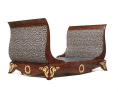 A French 19th century mahogany and giltwood lit en bateauin the manner of Jacob Desmalter