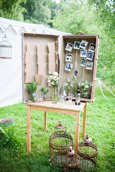Rustic table plan idea for a quirky outdoor wedding, using a vintage suitcase, using stamped names on brown recycled paper.  From 'An Eco-Friendly Woodland Wedding With Sofas Swinging In The Trees!' on www.lovemydress.net.  Photography http://www.sarahleggephotography.co.uk/