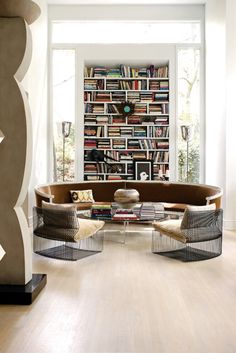Round / circular sofa against the bookshelf!