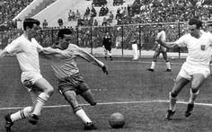 Mario Zagallo (second left), the Brazil winger, avoids a tackle from Johnny Haynes, the Fulham and England inside forward, during Brazil's's 3-1 victory to seal their place in the semis