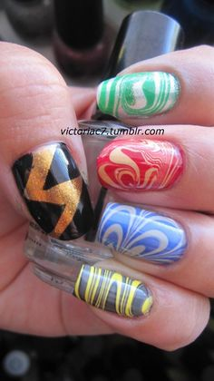 Harry Potter themed water marble! Each nail has the different house colors, and the thumb is a lightning bolt for Harry!