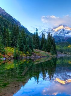 The Maroon Bells, Colorado The most photographed spot in Colorado, the Maroon Bells are twin peaks in Aspen's Elk Mountains, separated by a glacial lake and surrounded by national forest. Swoon.
