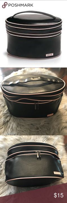 Mary kay black beauty makeup bag case organizer Mary Kay beauty train case. It is black with light pink trim. Two zipper compartments with pockets to hold makeup and brushes. This is brand new! Great for organizing makeup, Traveling or a great Christmas gift!   Dimensions:12x7x7 Mary Kay Bags Cosmetic Bags & Cases