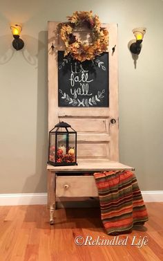 """Hand-made hall tree/entryway bench with a drawer. This piece was made from an old door and dresser. There are two hooks to hang belongings. The door also has a chalkboard so you can leave messages for your family. This is painted with chalk painted and protected with dark wax. Dimensions: 30"""" wide, 78"""" high and 19 1/2"""" deep"""