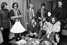 The Bee Gees take a cigarette break and hang with Cream at the Copenhagen Hotel lobby in February 1968. From left to right: Robin Gibb, Jack Bruce, Colin Peterson, Vince Melouney, Ginger Baker. Seated: Barry Gibb, Maurice Gibb, Eric Clapton (if I'm not mistaken, I think Robert Stigwood at one time early in Eric's career represented him)