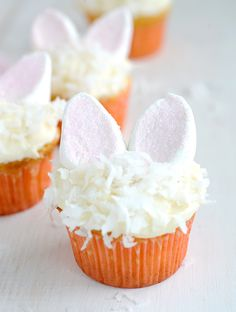 Bunny Coconut Cupcakes with bunny ears made of marshmallows and sprinkles!