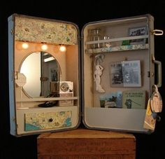 Suitcase Cabinet by BenclifDesigns.This upcycled custom creation is made from a vintage suitcase. Complete with wall hanging hardware, lights, shelves, mirror, collectibles, and cork board, this seller gathers information regarding the buyer's personal style and creates a customized wall cabinet reflecting their interests.