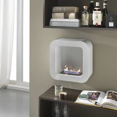 Modern stylish Bioethanol fireplace with a burner 500 ml Portable Fireplace, Bioethanol Fireplace, Bathroom Medicine Cabinet, Master Bathroom, Floating Shelves, Modern, Sweet Home, Living Room, Mirror