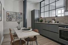 Stylish turn of the century home in grey and beige  - via Coco Lapine Design
