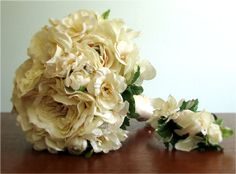 New Dreams Bridal Bouquet and Groom's Boutonniere - vanilla colored silk flower bouquet with fully opened roses, ranunculus, delphinium, and hydrangea, hand tied with satin and lace.