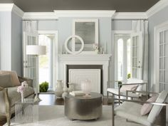 Gorgeous Living Room Fireplace Design Also Blue Painted Wall Idea Feat Cool Side Table With Transparent Material