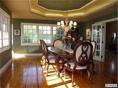 "This dining room was the site of so many family celebrations!  How many times did we sing ""Happy Birthday!"" to family and friends gathered around the big dining room table?  We had a wonderful Bridal Tea for our daughter in this room (well, OK, in the whole home).  It is filled with memories.  I have pictures to prove it."