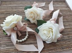 Wrist Corsage, White rose with champagne ribbon on pearl bracelet Prom Flowers, Silk Flowers, Wedding Flowers, White Boutonniere, Corsage And Boutonniere, Boutonnieres, Ivory Roses, White Roses, Bridesmaid Corsage