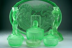 VINTAGE GLASS: DRESSING TABLE BOTTLE, SETS, BOXES, POTS, & RELATED. 1930s WALTHER & SÖHNE NYMPHEN MOULDED URANIUM GLASS DRESSING TABLE SET