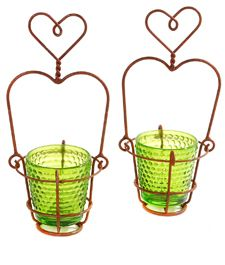 Mini Heart Basket - votive holder - these are super cute - site also shows doubles, baskets of 6, wall mount, triples, other variations - would make great little hanging baskets for candles - these would also be a cute design for little planter with climbing flowers/vines on wire  **********************************************  Grand Illusions - #glass #votive #wire #heart #basket #holder #hanging #candle #crafts (wire + candle + planter boards) - tå√