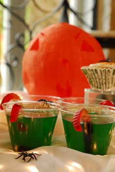 """Halloween treat for kids! Green jello, gummy worms, sprinkle the top with crush Oreos for yummy """"dirt"""" ingrid hoffmann desserts"""