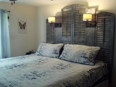 My new (old) headboard <3 Made with shutters taken off of a church that was built in 1909 and extra filler boards to make it fit my Cal King sized bed.