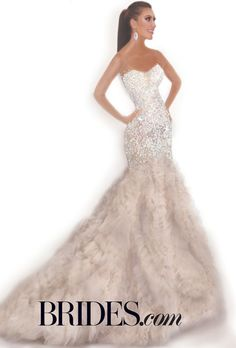"Brides.com: Kim Kardashian's Wedding Dress: Fantasy Designer Sketches. Watters  Talk about glam! Watters also decided that Kim K's wedding dress could use a touch of color. And this curve-skimming silhouette isn't without some serious bling. ""With her amazing skin-tone and new blonde hair color, I imagined her wearing a soft nude blush color, which she wears so well,"" says Vatana Watters, President and Founder of Watters. ""The dress is made of our Oatmeal tulle, soft watercolor-printed ..."