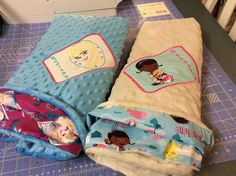 Handmade minky blankets...one with Frozen, the other with Doc McStuffins embroidery designs and names added