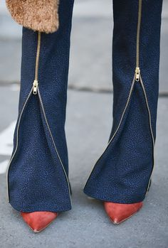 Zipped-leg trousers and pointy red heels.